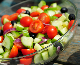 Cherry tomato, cucumber and black olive salad with basil yogurt dressing